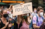 People protest for the climate during a climate strike in Cologne, Germany, Friday, Sept. 24, 2021. (AP Photo/Martin Meissner)