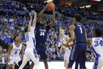 Georgetown's Qudus Wahab (34) shoots over Creighton's Marcus Zegarowski (11) during the first half of an NCAA college basketball game in Omaha, Neb., Wednesday, March 4, 2020. (AP Photo/Nati Harnik)