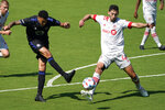 CF Montreal forward Bjorn Johnsen, left, attempts a shot on the goal as Toronto FC defender Omar Gonzalez defends during the second half of an MLS soccer match, Saturday, April 17, 2021, in Fort Lauderdale, Fla. CF Montreal won 4-2. (AP Photo/Lynne Sladky)