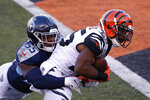 Cincinnati Bengals' Giovani Bernard (25) goes in for a touchdown while being tackled by Tennessee Titans' Jayon Brown (55) during the second half of an NFL football game, Sunday, Nov. 1, 2020, in Cincinnati. (AP Photo/Gary Landers)