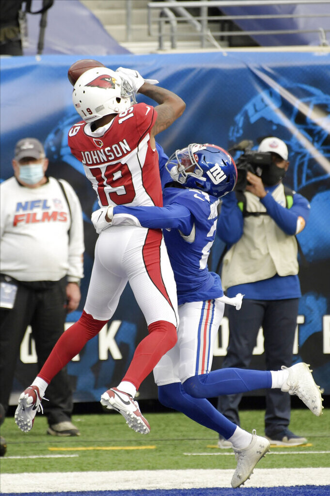 New York Giants' James Bradberry, right, breaks up a pass in the end zone intended for Arizona Cardinals' KeeSean Johnson (19) during the first half of an NFL football game, Sunday, Dec. 13, 2020, in East Rutherford, N.J. (AP Photo/Bill Kostroun)
