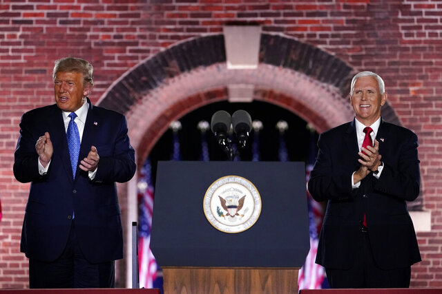 Vice President Mike Pence stands on stage with President Donald Trump after Pence spoke on the third day of the Republican National Convention at Fort McHenry National Monument and Historic Shrine in Baltimore, Wednesday, Aug. 26, 2020. (AP Photo/Andrew Harnik)