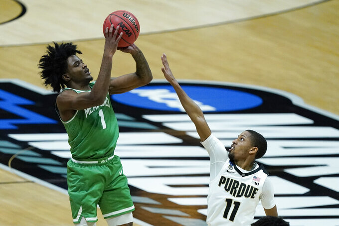 North Texas's Mardrez McBride (1) shoots over Purdue's Isaiah Thompson (11) during the second half of a first-round game in the NCAA men's college basketball tournament at Lucas Oil Stadium, Friday, March 19, 2021, in Indianapolis. (AP Photo/Darron Cummings)