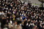 Spectators wearing face masks watch a skater perform during a free skating of an ISU Grand Prix of Figure Skating competition in Kadoma near Osaka, Japan, Saturday, Nov. 28, 2020. (AP Photo/Hiro Komae)