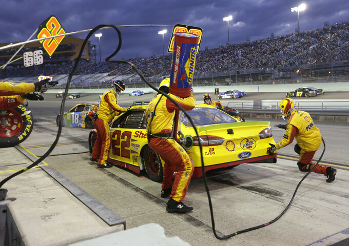 Joey Logano (22) makes a pit stop during the NASCAR Cup Series Championship auto race at the Homestead-Miami Speedway, Sunday, Nov. 18, 2018, in Homestead, Fla. (AP Photo/Lynne Sladky)