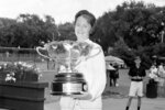 FILE - In this July 21, 1963, file photo, Nancy Richey poses with her trophy after winning the women's singles title of the National Clay Court tennis championships in River Forest, Ill.  It's the 50th anniversary of Billie Jean King and eight other women breaking away from the tennis establishment in 1970 and signing a $1 contract to form the Virginia Slims circuit. That led to the WTA Tour, which offers millions in prize money. Richey was one of the nine. (AP Photo/LO, File)