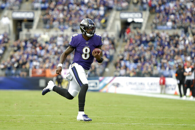 Baltimore Ravens quarterback Lamar Jackson runs for a touchdown against the Cincinnati Bengals during the first half of a NFL football game Sunday, Oct. 13, 2019, in Baltimore. (AP Photo/Gail Burton)