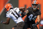 Cleveland Browns linebacker Sione Takitaki, right, covered receiver Donovan Peoples-Jones during NFL football practice in Berea, Ohio, Wednesday, July 28, 2021. (AP Photo/David Dermer)