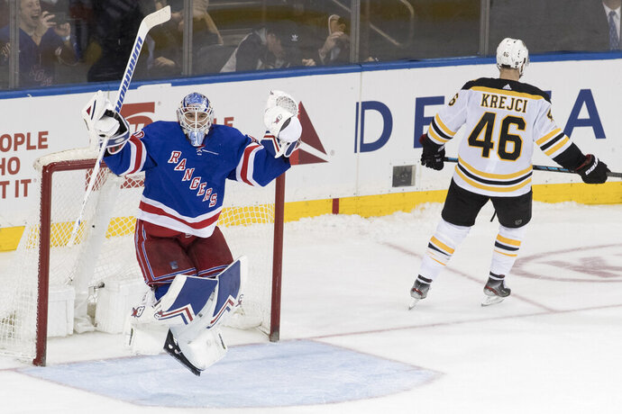 New York Rangers goaltender Alexandar Georgiev reacts a save against against Boston Bruins center David Krejci (46) during the shootout in an NHL hockey game Wednesday, Feb. 6, 2019, at Madison Square Garden in New York. The Rangers won 4-3. (AP Photo/Mary Altaffer)