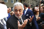 Placido Domingo talks to fans at the 'Festspielhaus' opera house after he performed 'Luisa Miller' by Giuseppe Verdi in Salzburg, Austria, Sunday, Aug. 25, 2019. Domingo is scheduled to appear onstage at the Salzburg Festival to perform for the first time since multiple women have accused the opera legend of sexual harassment in allegations brought to light by The Associated Press. (AP Photo/Matthias Schrader)