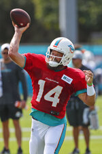 Miami Dolphins quarterback Ryan Fitzpatrick passes during a drill at the teams NFL football training camp, Tuesday, July 30, 2019 in Davie, Fla. Fitzpatrick is officially the front-runner for the starting job at QB. (AP Photo/Wilfredo Lee)