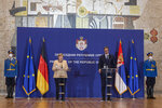 German Chancellor Angela Merkel, 2nd left, speaks during a joint press conference with Serbian president Aleksandar Vucic, 2nd right, in Belgrade, Serbia, Monday, Sept. 13, 2021. Merkel is on a farewell tour of the Western Balkans, as she announced in 2018 that she wouldn't seek a fifth term as Germany's Chancellor. (AP Photo/Marko Drobnjakovic)
