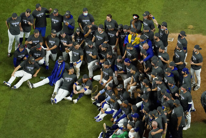 Los Angeles Dodgers pose for a group picture after defeating the Tampa Bay Rays 3-1 to win the baseball World Series in Game 6 Tuesday, Oct. 27, 2020, in Arlington, Texas. (AP Photo/David J. Phillip)