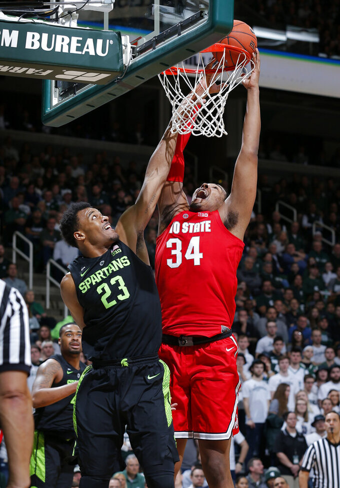 Ohio State's Kaleb Wesson, right, shoots and draws a foul against Michigan State's Xavier Tillman (23) during the first half of an NCAA college basketball game, Sunday, Feb. 17, 2019, in East Lansing, Mich. (AP Photo/Al Goldis)