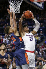 Gonzaga forward Rui Hachimura (21) shoots past Pepperdine forward Kessler Edwards (15) during the first half of an NCAA college basketball game in Spokane, Wash., Thursday, Feb. 21, 2019. (AP Photo/Young Kwak)