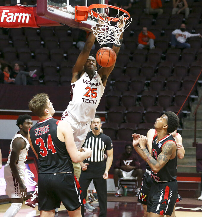 Virginia Tech's Justyn Mutts (25) scores past the VMI defense during the second half of an NCAA college basketball game, Thursday, Dec. 3, 2020 in Blacksburg, Va. (Matt Gentry/The Roanoke Times via AP, Pool)