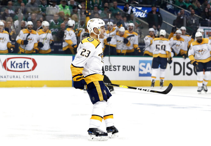 Nashville Predators center Rocco Grimaldi (23) celebrates his goal against the Dallas Stars in the second period of Game 3 in an NHL hockey first-round playoff series in Dallas, Monday, April 15, 2019. (AP Photo/Tony Gutierrez)