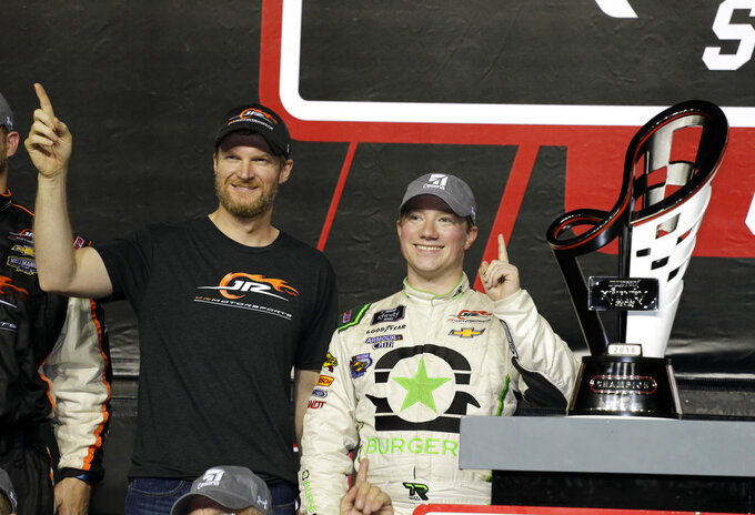 Tyler Reddick, right, poses with Dale Earnhardt Jr., co-owner of JR Motorsports, left, after winning the NASCAR Xfinity Series championship auto race at the Homestead-Miami Speedway, Saturday, Nov. 17, 2018, in Homestead, Fla. (AP Photo/Terry Renna)