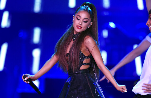FILE - In this June 2, 2018 file photo., Ariana Grande performs at Wango Tango at Banc of California Stadium in Los Angeles.  Grande, who won her first Grammy earlier this year, scored five Grammy Award nominations on Wednesday, Nov. 20, 2019. (Photo by Chris Pizzello/Invision/AP, FIle)