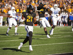 Missouri defensive back Christian Holmes (21) returns an interception for a touchdown during the first half of an NCAA college football game against Memphis, Saturday, Oct. 20, 2018, in Columbia, Mo. (AP Photo/L.G. Patterson)