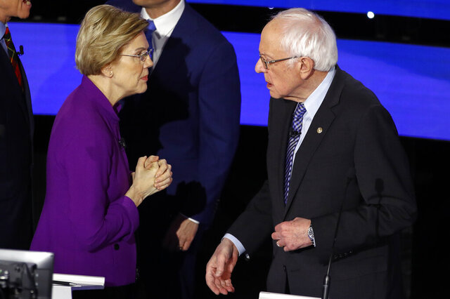 Democratic presidential candidate Sen. Elizabeth Warren, D-Mass., left and Sen. Bernie Sanders, I-Vt., talk Tuesday, Jan. 14, 2020, after a Democratic presidential primary debate hosted by CNN and the Des Moines Register in Des Moines, Iowa. Candidate businessman Tom Steyer looks on (AP Photo/Patrick Semansky)