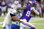 Minnesota Vikings tight end Irv Smith tries to break a tackle by Detroit Lions outside linebacker Devon Kennard, left, after catching a pass during the second half of an NFL football game, Sunday, Dec. 8, 2019, in Minneapolis. (AP Photo/Andy Clayton-King)
