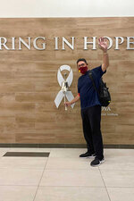 In this photo provided by Inova Health System, Washington Football Team NFL football head coach Ron Rivera rings the bell at the Inova Schar Cancer Institute in Fairfax, Va., following his final treatment for a form of skin cancer, on Monday, Oct. 26, 2020. Rivera gets to rest up with the bye week before hosting the New York Giants on Nov. 8. (Inova Health System via AP)
