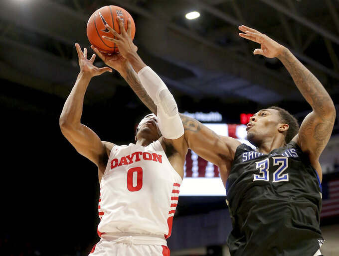 Dayton's Rodney Chatman (0) battles St. Louis forward Jimmy Bell Jr (32) for a rebound during the second half of an NCAA college basketball game, Saturday, , Feb. 1, 2020, in Dayton, Ohio. (AP Photo/Tony Tribble)