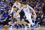 Duke guard Alex O'Connell (15) and Notre Dame guard Nikola Djogo chase the ball during the second half of an NCAA college basketball game in Durham, N.C., Saturday, Feb. 15, 2020. (AP Photo/Gerry Broome)