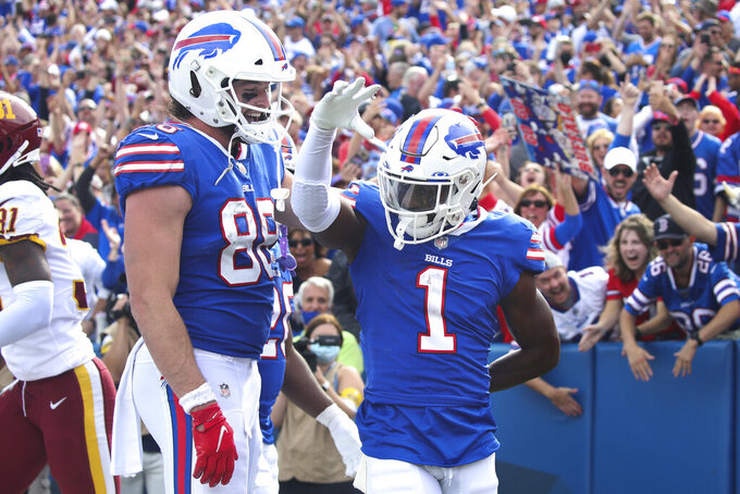 Buffalo Bills' Dawson Knox (88) celebrates with Emmanuel Sanders (1) after Sanders caught a pass for a touchdown during the second half of an NFL football game against the Washington Football Team, Sunday, Sept. 26, 2021, in Orchard Park, N.Y. (AP Photo/Jeffrey T. Barnes)