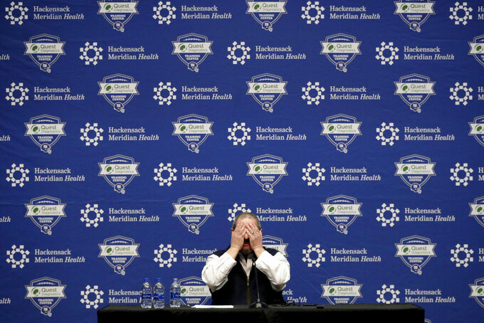 New York Giants general manager Dave Gettleman grabs his face while speaking during an end-of-season press conference at the NFL football team's training facility, Wednesday, Jan. 2, 2019, in East Rutherford, N.J. The Giants finished with a record of 5-11, last in the NFC East division. (AP Photo/Julio Cortez)