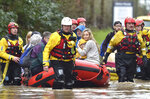 """Rescue operations continue as emergency services take residents to safety, in Nantgarw, Wales, Sunday Feb. 16, 2020. Storm Dennis is roaring across Britain with high winds and heavy rains, prompting authorities to issue 350 flood warnings, including a """"red warning"""