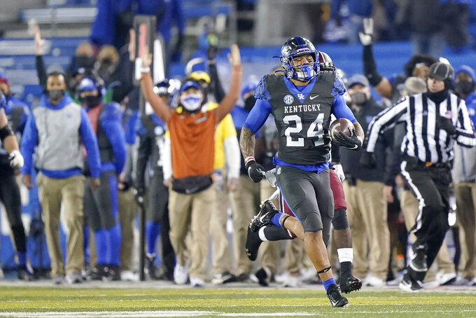 Kentucky running back Chris Rodriguez Jr. (24) runs for a touchdown during the second half of an NCAA college football game against South Carolina, Saturday, Dec. 5, 2020, in Lexington, Ky. (AP Photo/Bryan Woolston)