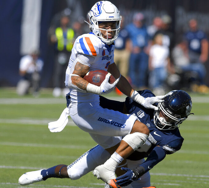 Boise State wide receiver Khalil Shakir (2) spins away from Utah State safety Dusten Ramseyer-Burdett (36) during the second half of an NCAA college football game Saturday, Sept. 25, 2021, in Logan, Utah. (Eli Lucero/The Herald Journal via AP)