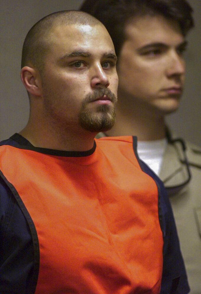 FILE - In this June 7, 1999, file photo, Zane Floyd makes an appearance in Clark County Justice Court in Las Vegas, to face charges of murder in the shooting deaths of four people inside an Albertsons grocery store on June 3. A day after Gov. Steve Sisolak and the top Democrat in the Legislature declared efforts to repeal the state's death penalty law dead, Clark County District Court Judge Michael Villani on Monday, May 10, 2021, pushed back to June 4 a hearing on the district attorney's request to set a late July date for the lethal injection of Zane Michael Floyd. Floyd, now 45, would be the first convicted killer put to death in Nevada since 2006. (Aaron Mayes/Las Vegas Sun via AP, Pool)