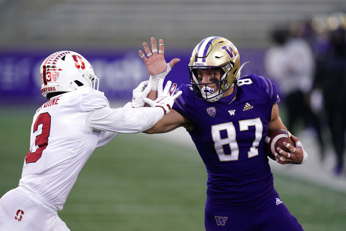 Washington's Cade Otton (87) is pushed out of bounds by Stanford's Malik Antoine during the second half of an NCAA college football game Saturday, Dec. 5, 2020, in Seattle. Stanford won 31-26. (AP Photo/Elaine Thompson)