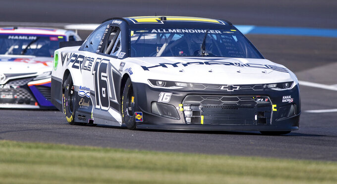 AJ Allmendinger (16) competes during a NASCAR Cup Series auto racing at Indianapolis Motor Speedway, Sunday, Aug. 15, 2021, in Indianapolis. (AP Photo/Doug McSchooler)