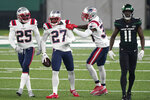 New England Patriots' J.C. Jackson (27) celebrates his interception of a pass intended for New York Jets' Denzel Mims, right, during the second half of an NFL football game, Monday, Nov. 9, 2020, in East Rutherford, N.J. (AP Photo/Corey Sipkin)