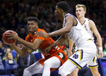 Miami's Anthony Walker (11) looks for a shot with pressure from Notre Dame's Juwan Durham during the first half of an NCAA college basketball game Sunday, Feb. 23, 2020, in South Bend, Ind. (AP Photo/Robert Franklin)