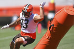 Cleveland Browns defensive linemen Tommy Togiai (93) participates in a drill during an NFL football practice at the team's training facility, Thursday, June 17, 2021, in Berea, Ohio. (AP Photo/David Dermer)