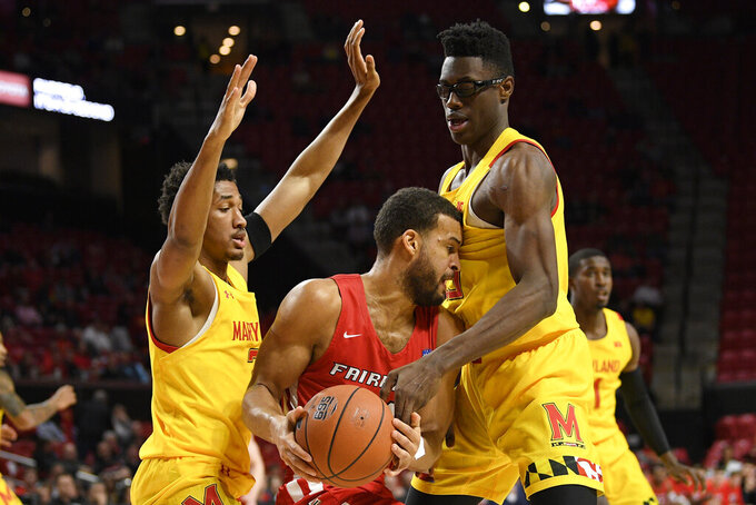 Maryland guard Aaron Wiggins, left, and forward Jalen Smith, right, defend against Fairfield guard Jesus Cruz, center, during the first half of an NCAA college basketball game, Tuesday, Nov. 19, 2019, in College Park, Md. (AP Photo/Nick Wass)
