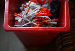 In this Jan. 18, 2018 photo, used needles sit in a container inside the Baltimore City Health Department's Needle Exchange Team van in Baltimore.   The overdose-reversal drug is a critical tool to easing America's coast-to-coast opioid epidemic. But not everyone on the front lines has all they need. Baltimore's health department is rationing its supplies of naloxone because it says it can't afford an adequate stockpile. (AP Photo/Patrick Semansky)
