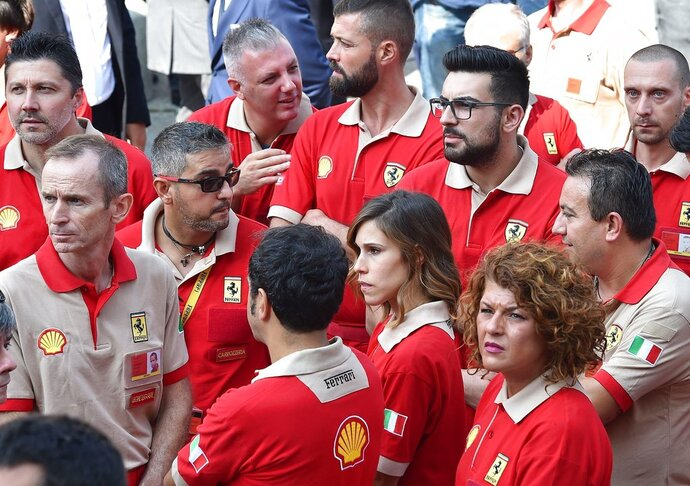Ferrari workers attend a commemorative Mass for late CEO Sergio Marchionne in Turin's cathedral, Italy, Friday, Sept. 14, 2018. The heir to Fiat's founding family, John Elkann, has paid an emotional farewell to the late CEO Sergio Marchionne, who died suddenly in July, saying