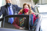 """Stephanie Williams, the head of the United Nations support mission for Libya and former U.S. State Department official, wearing a protective face mask against the spread of the coronavirus leaves the building after a meeting of the fourth round of the Libyan Joint Military Commission, at the European headquarters of the United Nations in Geneva, Switzerland, Monday, Oct. 19, 2020. Military leaders from Libya's warring sides met Monday in Geneva in hopes of a U.N.-brokered breakthrough that could pave the way for a """"complete and permanent cease-fire"""" in the conflict-ridden North African country. (Salvatore Di Nolfi/Keystone via AP)"""