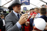 FILE - Country music star Tim McGraw signs an autograph as he walks the red carpet ahead of the first round at the NFL football draft on April 25, 2019, in Nashville, Tenn. McGraw turns 54 on May 1. (AP Photo/Steve Helber, File)