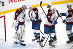 Colorado Avalanche players celebrate a 3-2 win over the Los Angeles Kings in an NHL hockey game Tuesday, Jan. 19, 2021, in Los Angeles. (AP Photo/Kyusung Gong)