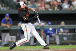 Baltimore Orioles' Richie Martin hits an infield single off Toronto Blue Jays' Nick Kingham during the third inning of a baseball game Friday, Aug. 2, 2019, in Baltimore. (AP Photo/Julio Cortez)