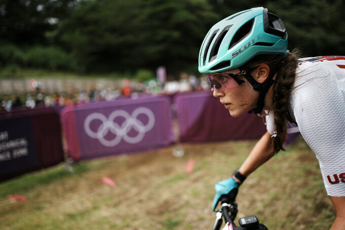 Kate Courtney of The United States competes during the women's cross-country mountain bike competition at the 2020 Summer Olympics, Tuesday, July 27, 2021, in Izu, Japan. (AP Photo/Thibault Camus)
