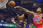 Cleveland Cavaliers' Collin Sexton (2) drives to the basket against Oklahoma City Thunder's Terrance Ferguson (23) in the first half of an NBA basketball game, Saturday, Jan. 4, 2020, in Cleveland. (AP Photo/Tony Dejak)