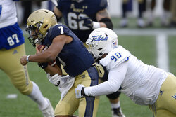 Navy quarterback Xavier Arline (7) is tackled by Tulsa defensive lineman Jaxon Player (90) during the first half of an NCAA college football game, Saturday, Dec. 5, 2020, in Annapolis, Md. (AP Photo/Nick Wass)